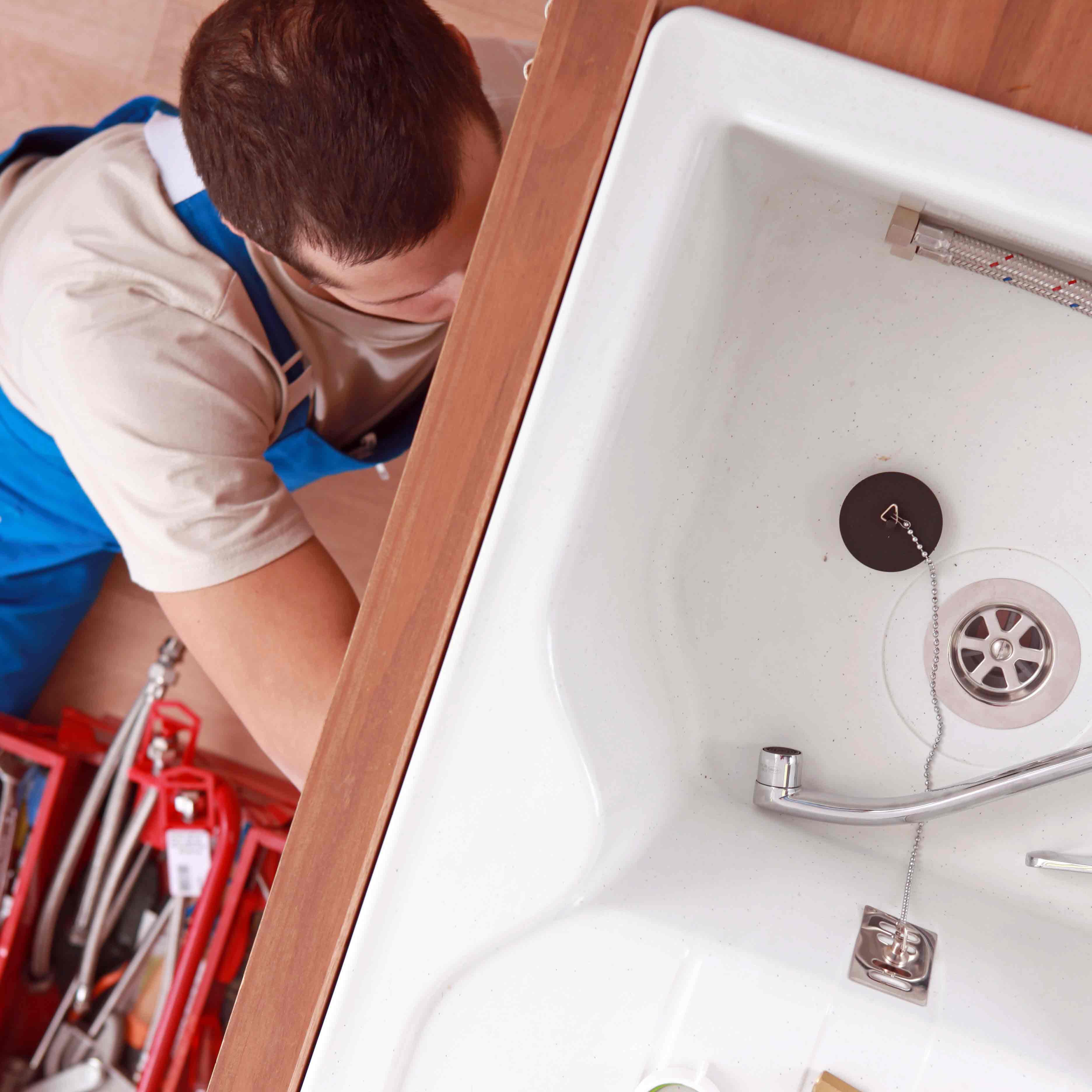 residential commercial plumbing plumber working